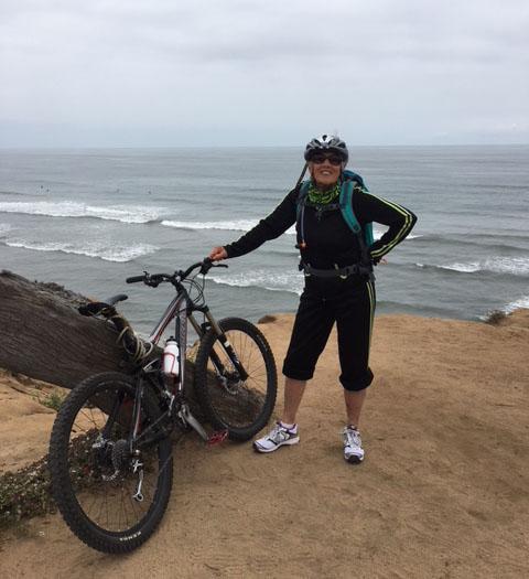 Kathleen Morrow biking at the Ocean